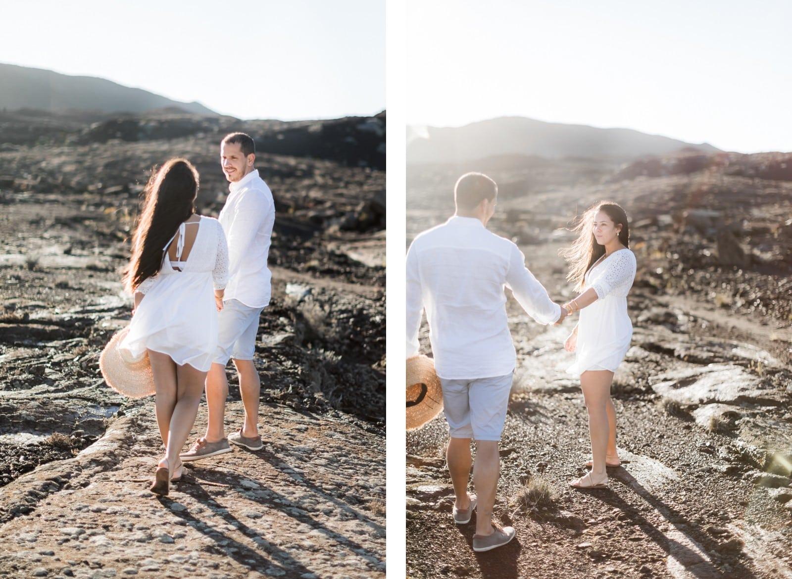 Photographie de Mathieu Dété, photographe de mariage et couple à Saint-Paul de la Réunion 974, présentant un couple qui se tient par la main sur les roches volcaniques au Pas des Sables