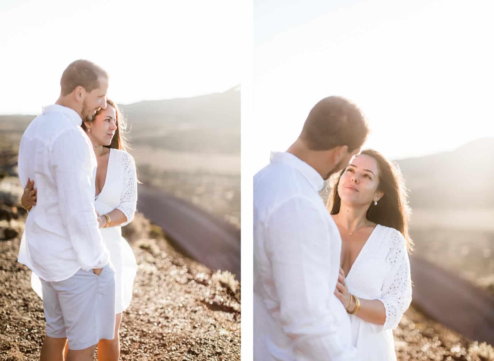 Photographie de Mathieu Dété, photographe de mariage et couple à Saint-Pierre de la Réunion 974, présentant une femme enlacée à son compagnon au lever du soleil à la Plaine des Sables
